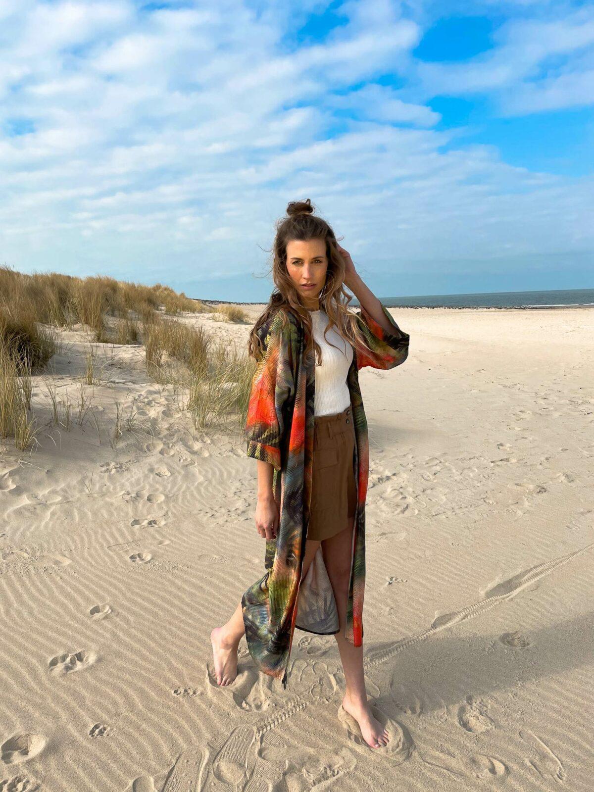 woman on the beach wearing a kimono