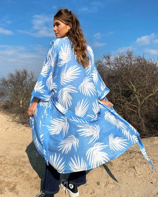 woman on the beach wearing a blue and white kimono