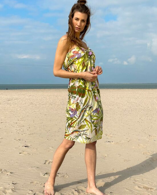 woman on the beach wearing a green pareo