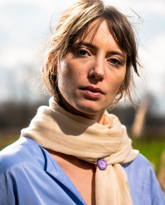 woman with a beige scarf