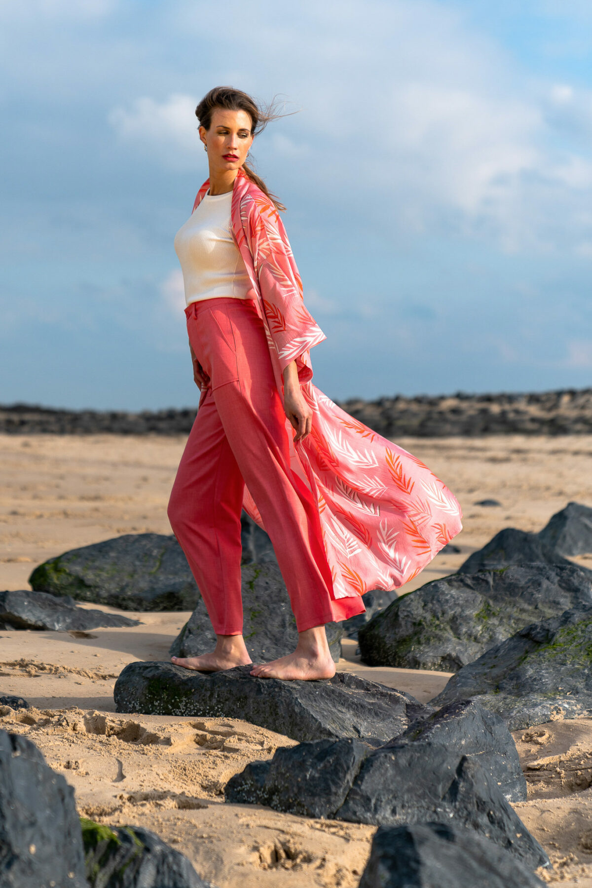 woman with coral pants and a red kimono
