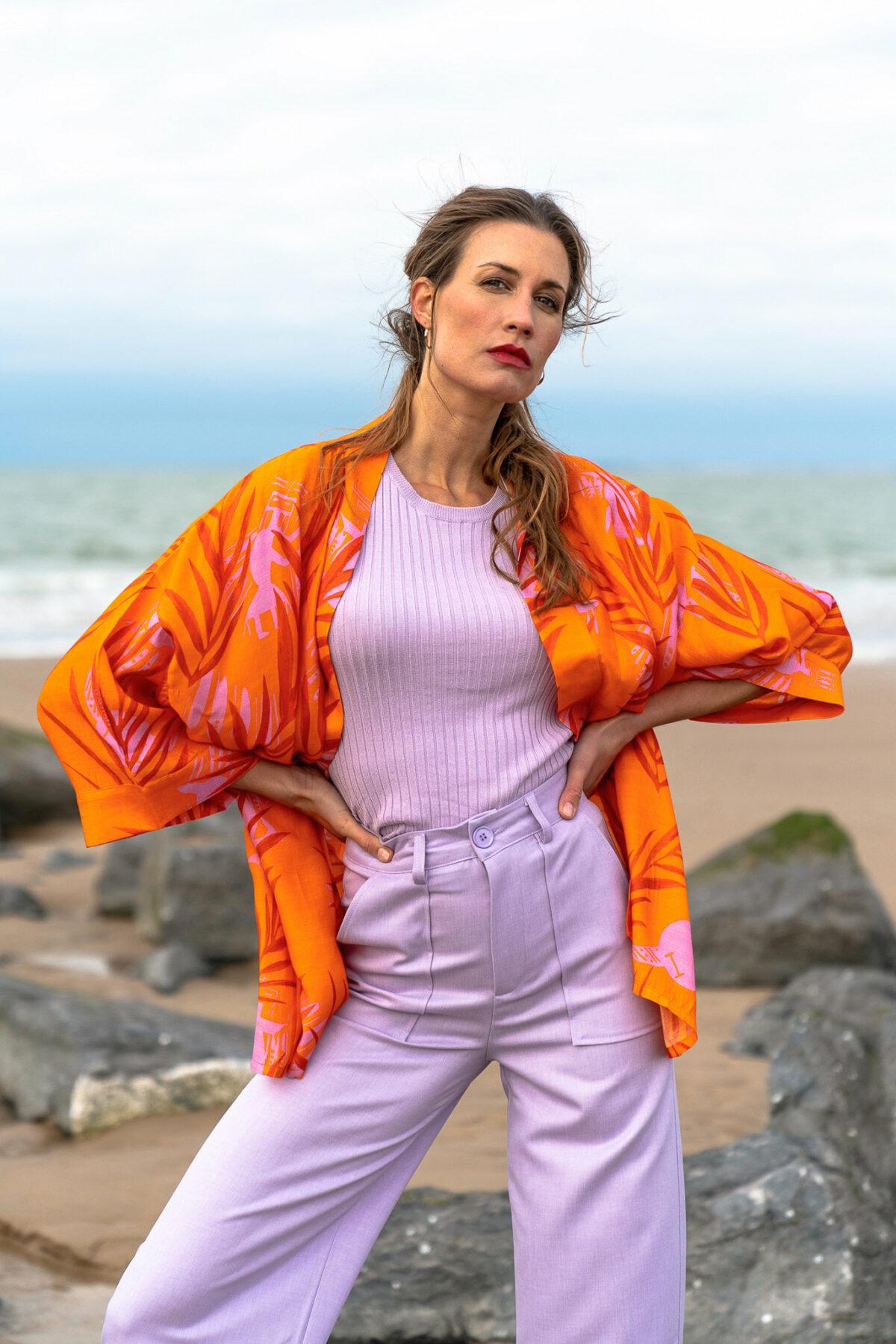 woman with a lilac top lilac pants and an orange kimono