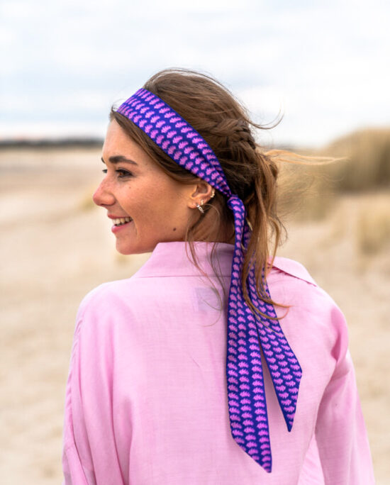 woman with a pastel pink kimono and a purple ribbon in her hair
