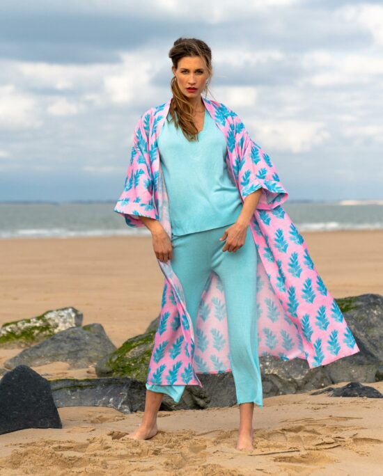 woman with a blue homesuit and a pink kimono