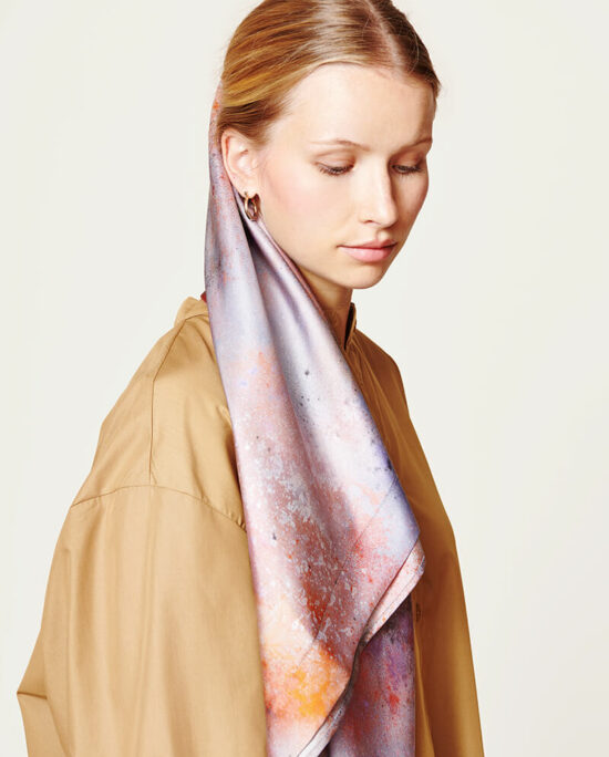 woman with a beige dress and a grey satin scarf