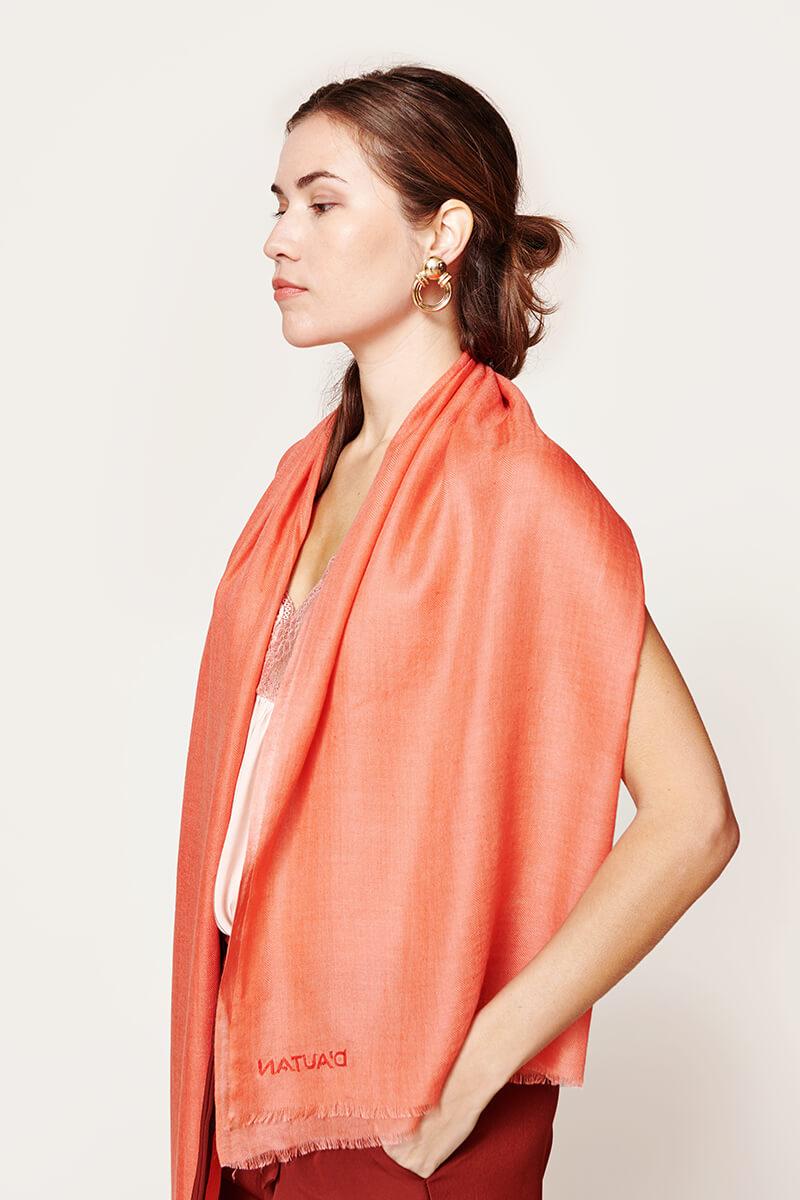woman wearing an orange coral scarf