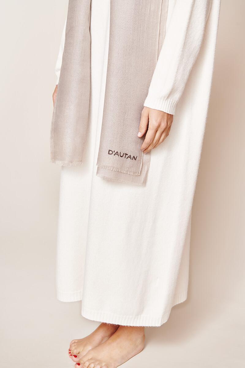 white dress with a grey scarf with logo