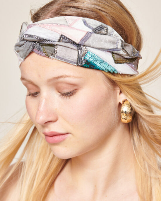 woman with a blue and grey headband
