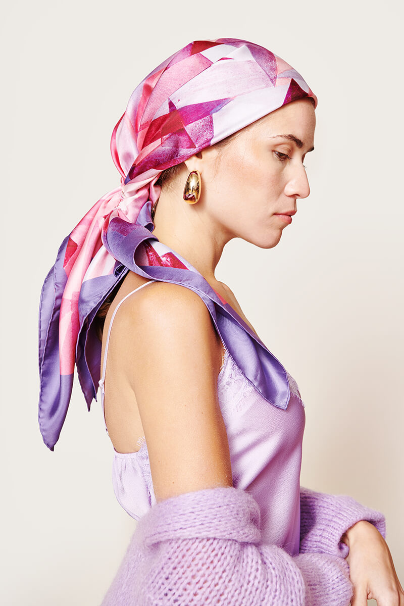 woman with a pink and purple scarf on her head