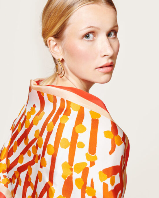 woman wearing an orange scarf on her back