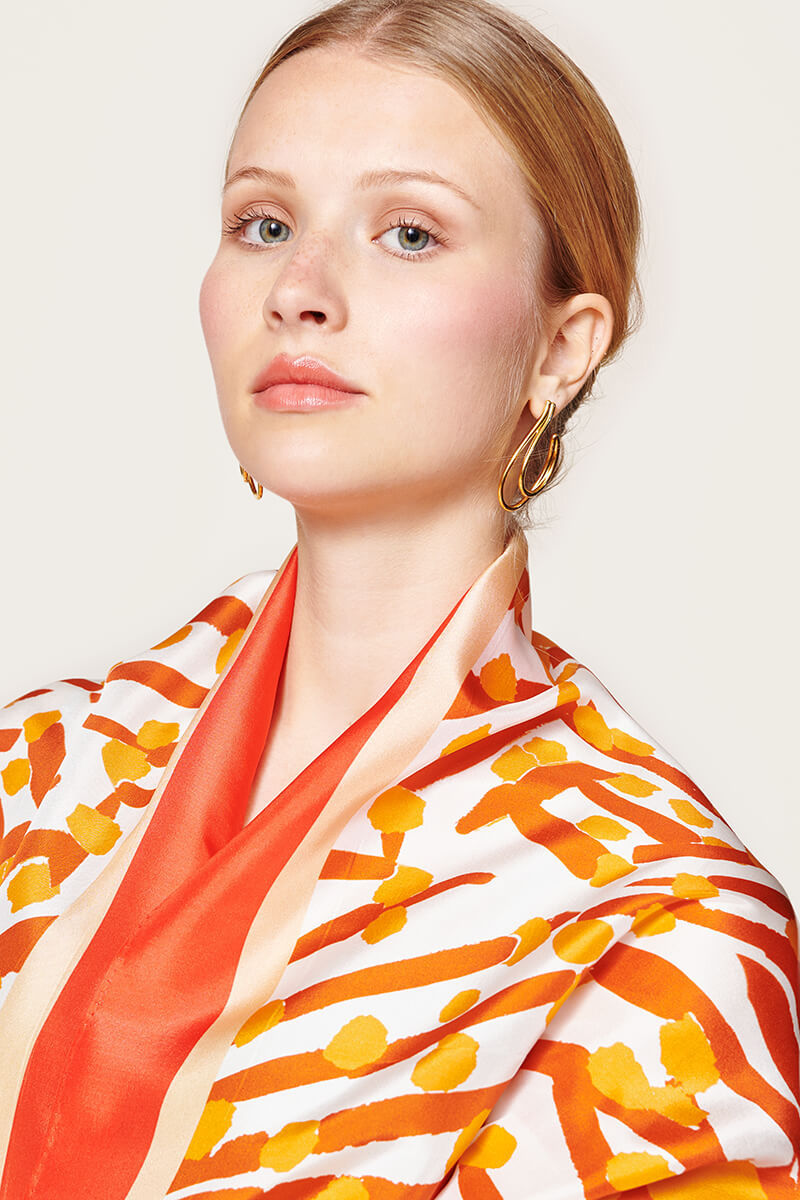 woman wearing an orange scarf