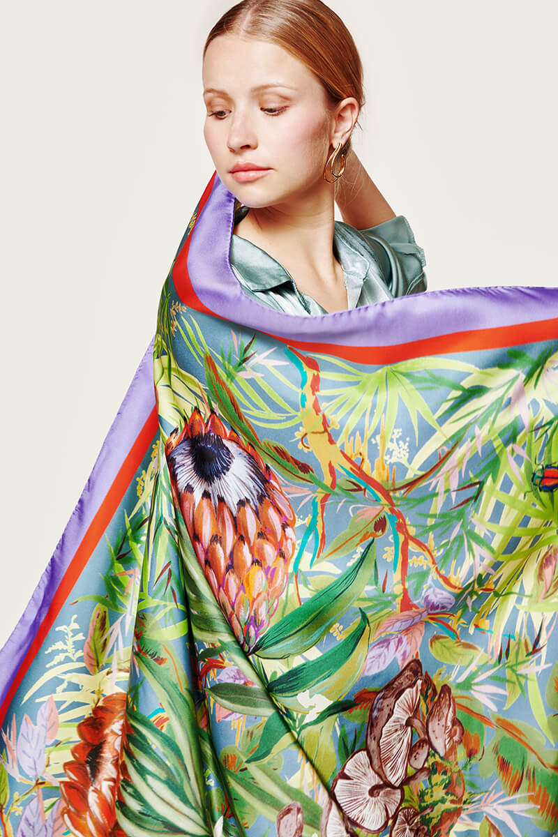 woman holding a green colourful scarf