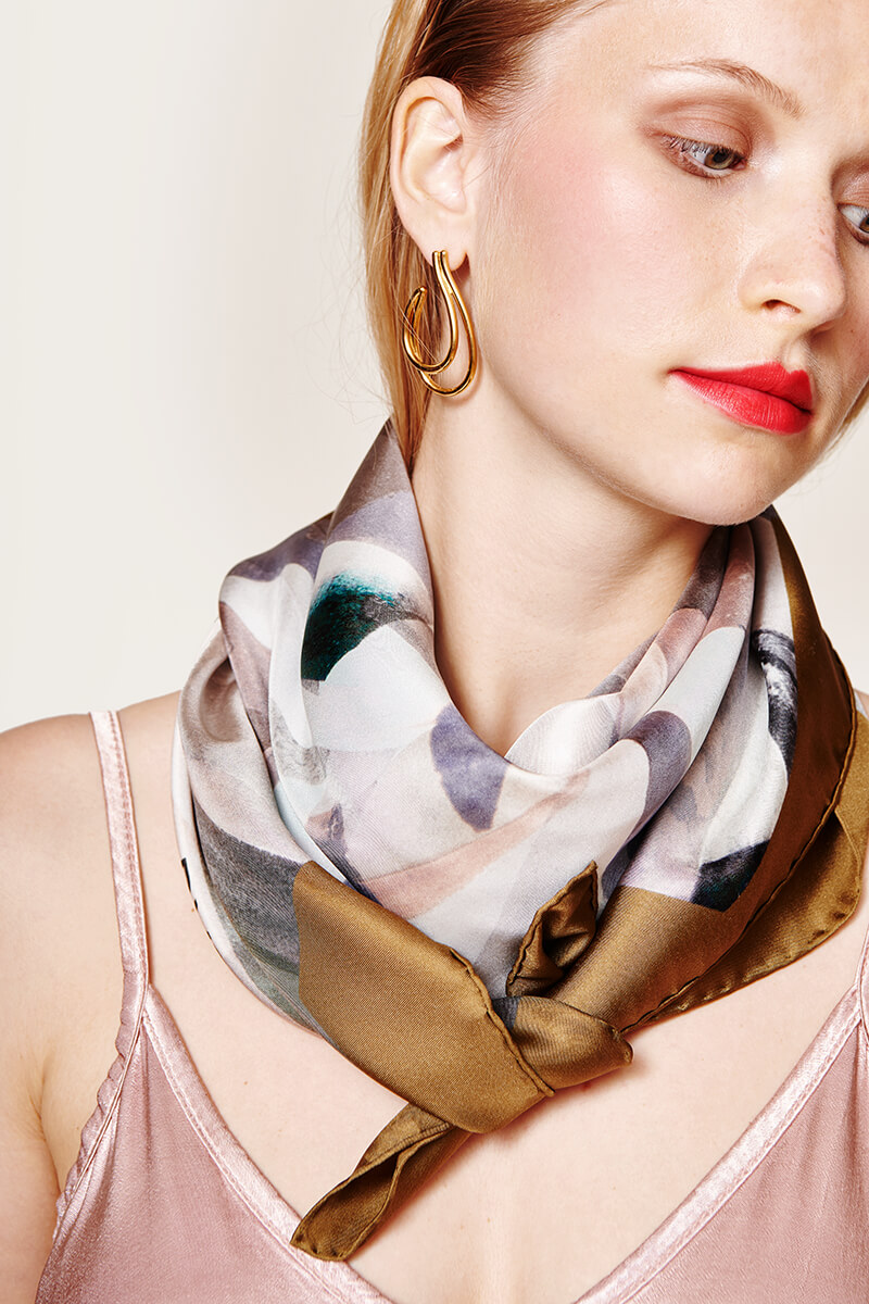 woman with a satin scarf on her neck