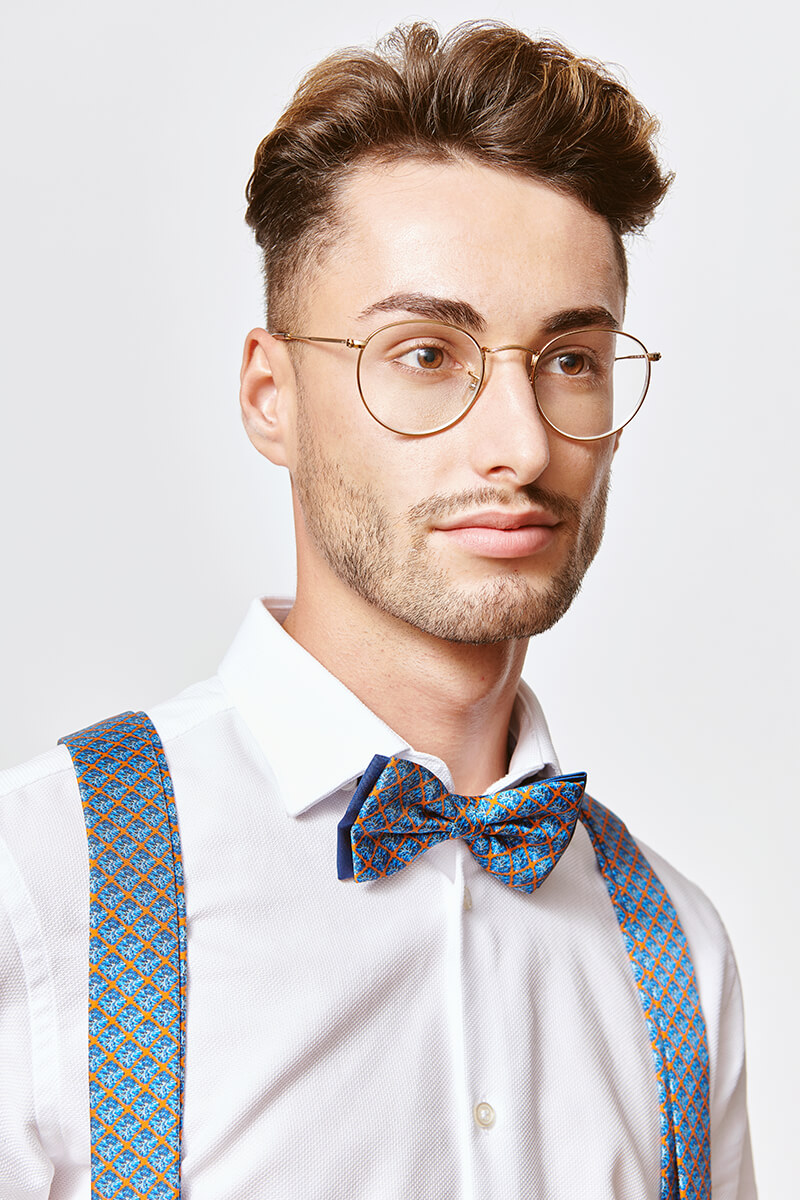 man with a blue bowtie and blue suspenders