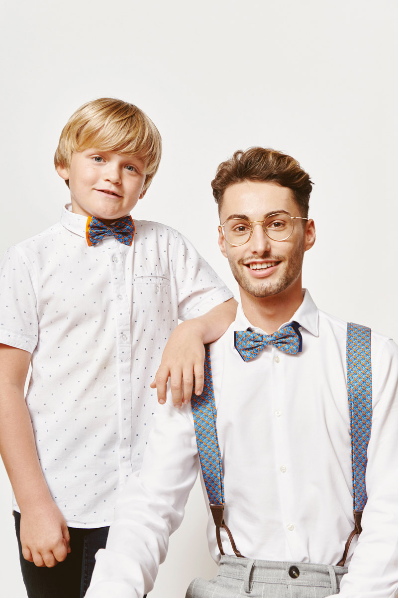son and dad with matching accesoires blue bowtie and blue suspenders