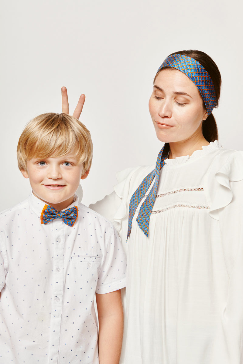 mom and son with matching accesoires blue hair tie and blue bowtie for children