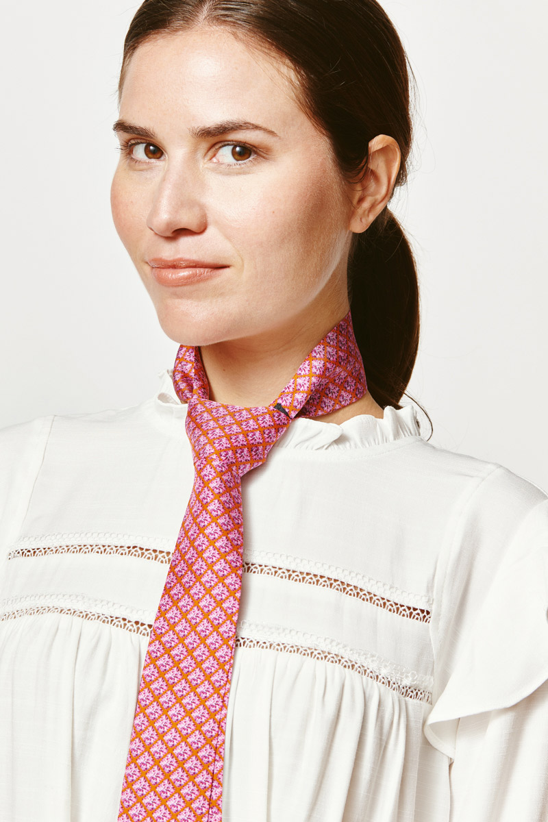woman with a pink ribbon tie