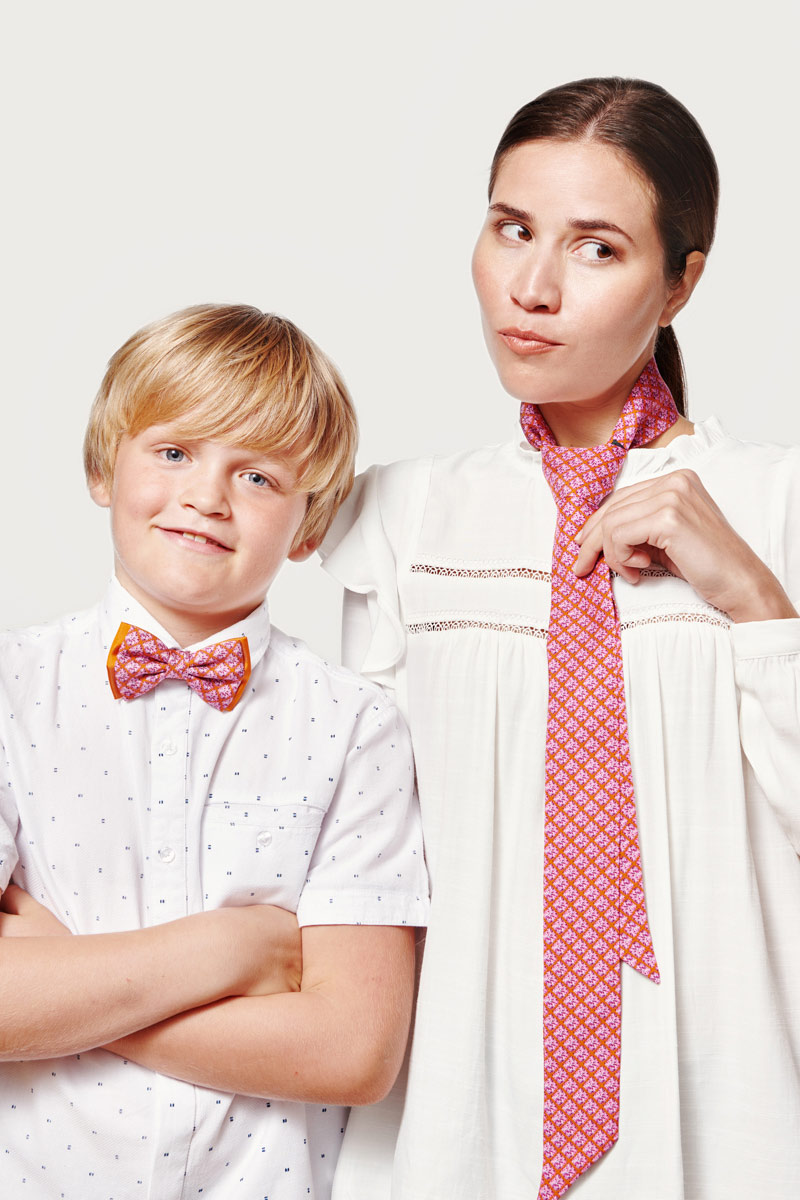 mom and her son with matching accesoires pink ribbon and pink bowtie