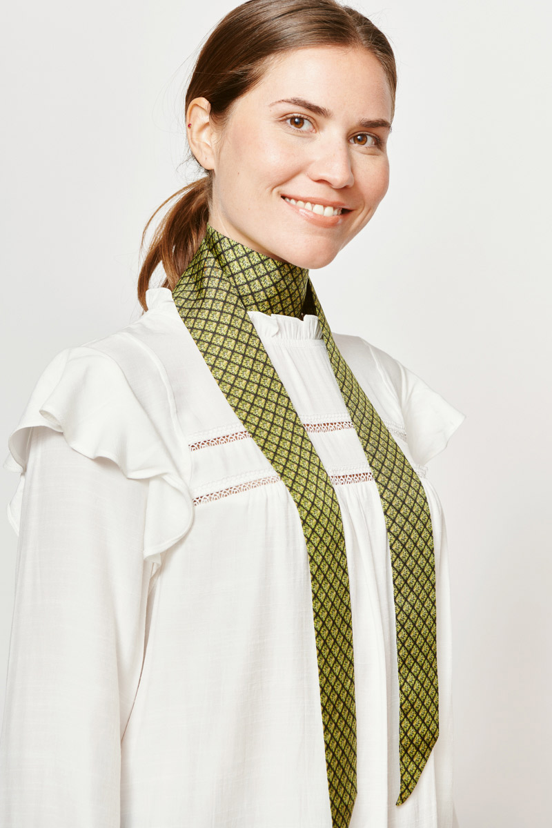 woman with a green and black ribbon