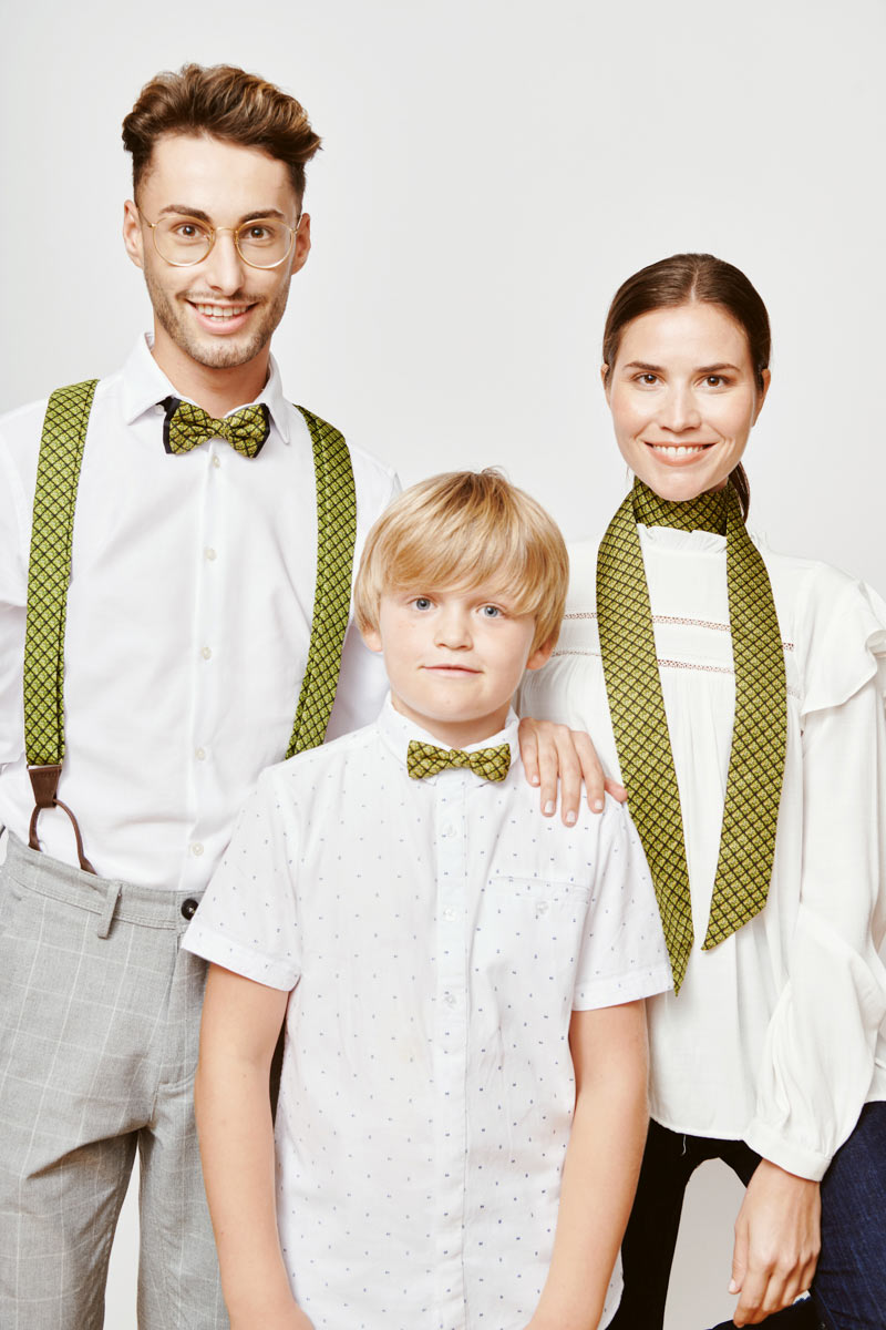 family with a green ribbon for women green suspenders and bowtie for men and green bowtie for children