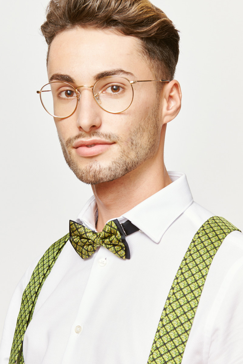 man with green suspenders and a green bowtie