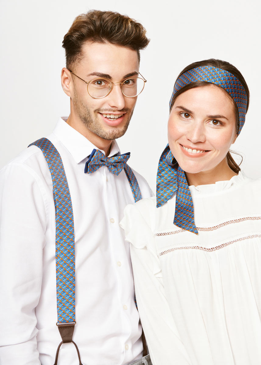 couple with matching accesoires blue tie blue bow and blue hair tie