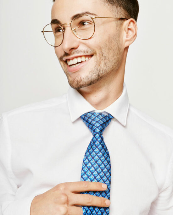 laughing man with a blue tie