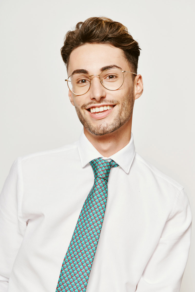laughing man with a green tie
