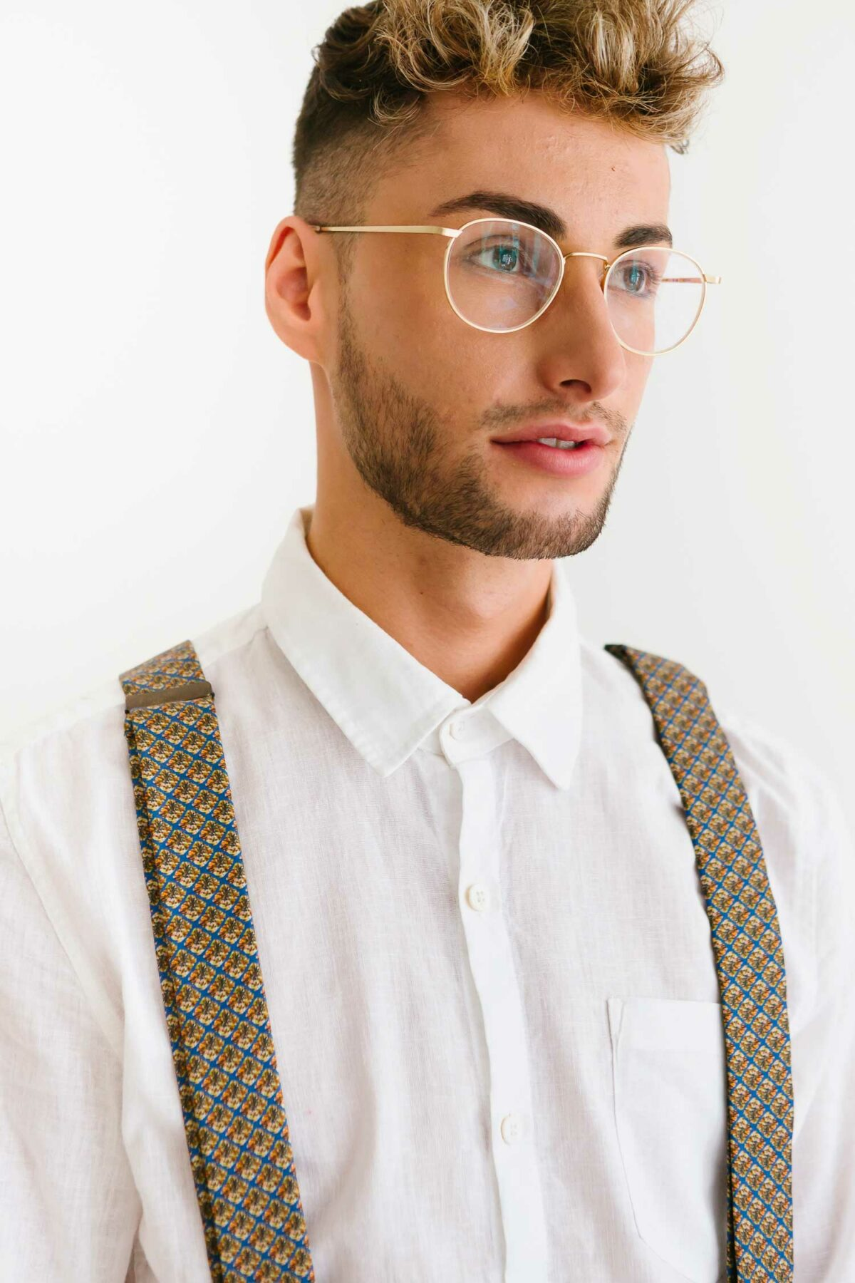 man with brown suspenders