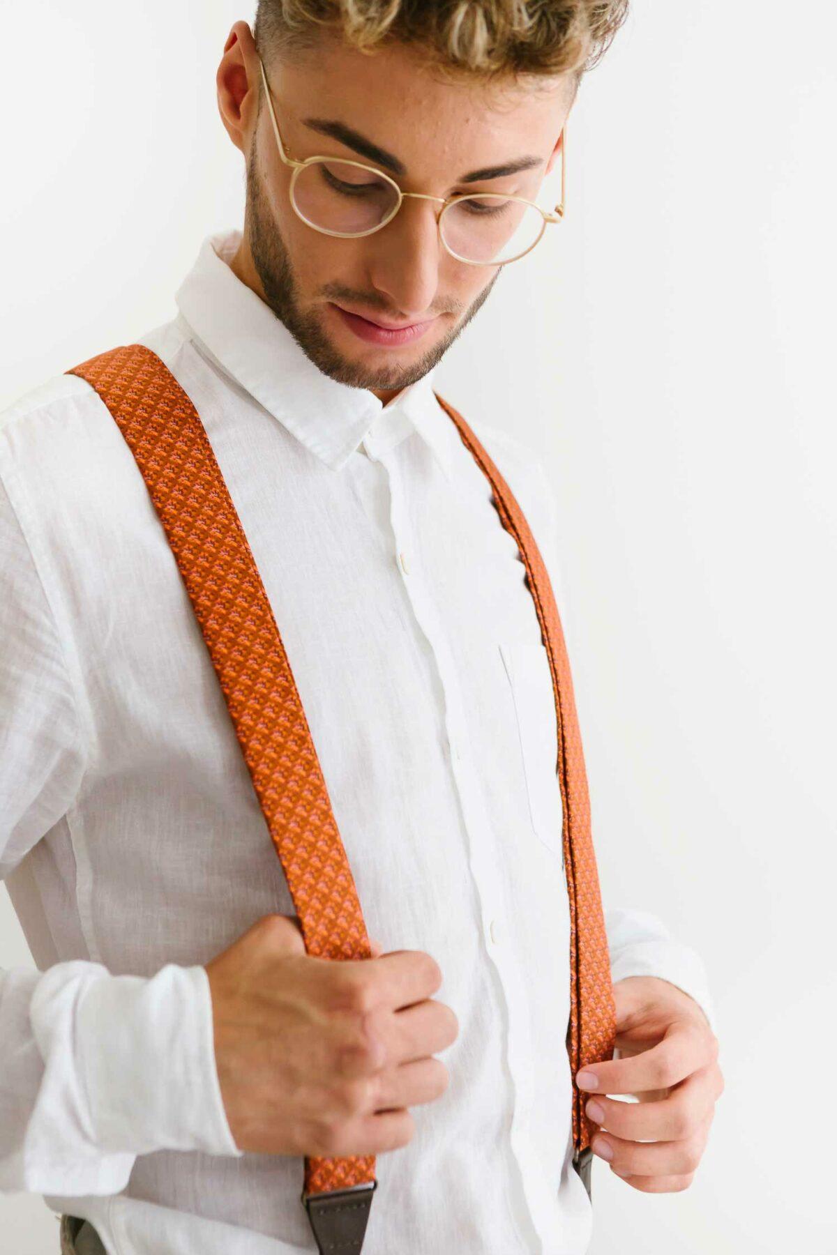man with rusty orange suspenders