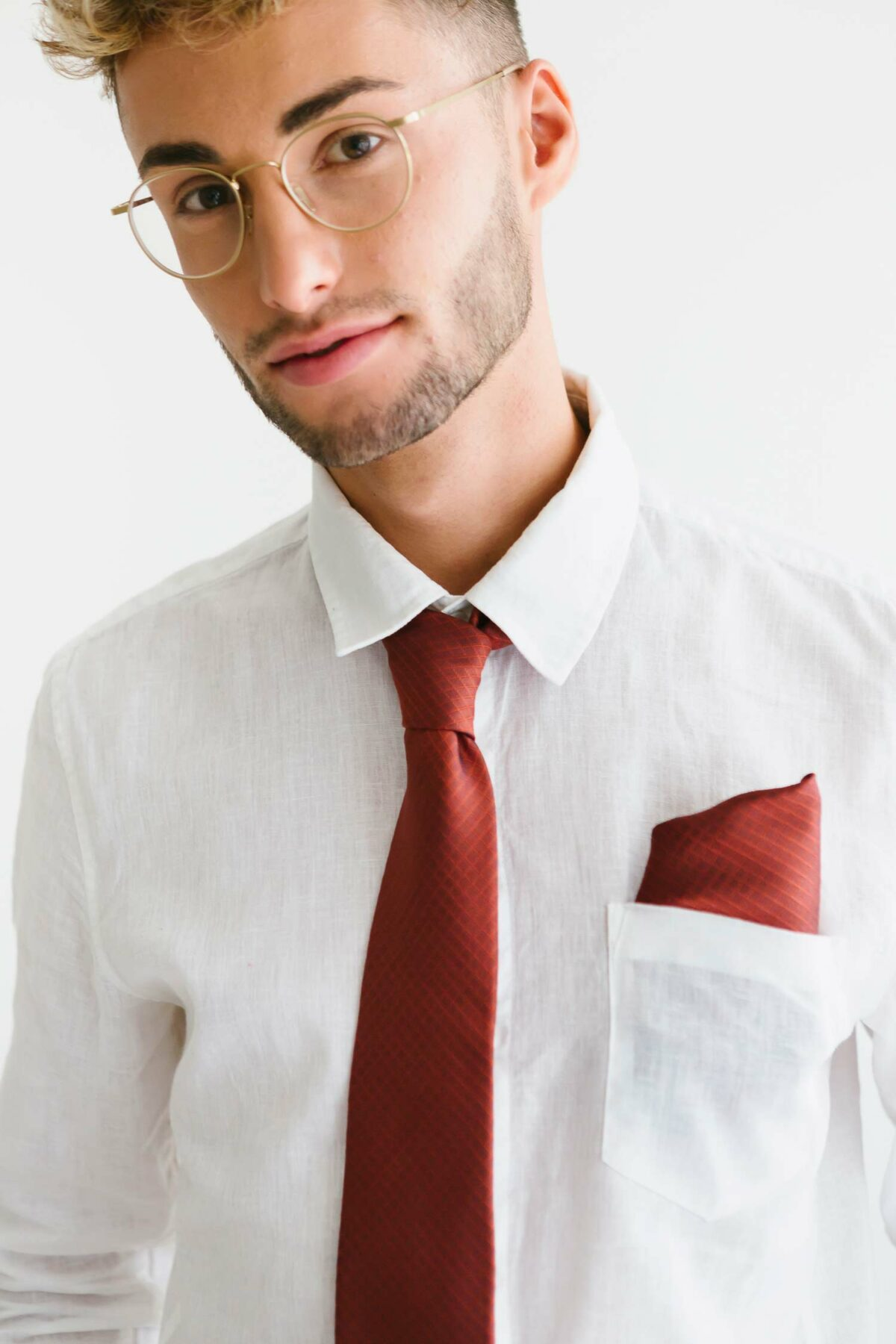 man with a rusty red tie and a pocket square