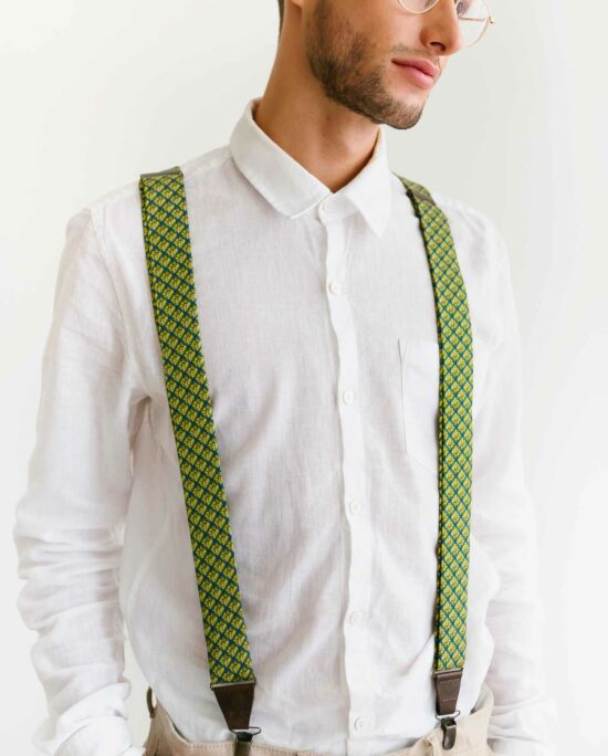 man with a green bowtie and green suspenders