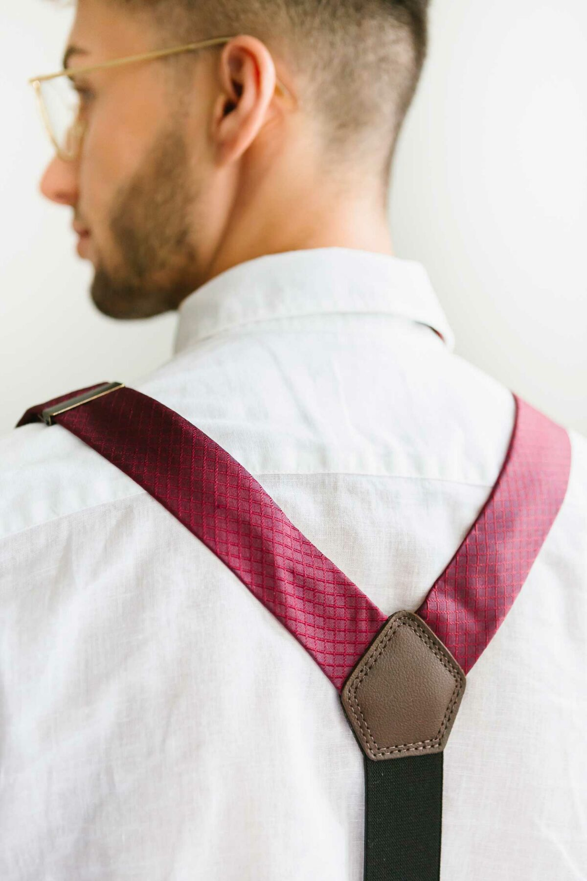 man with bordeaux red suspenders