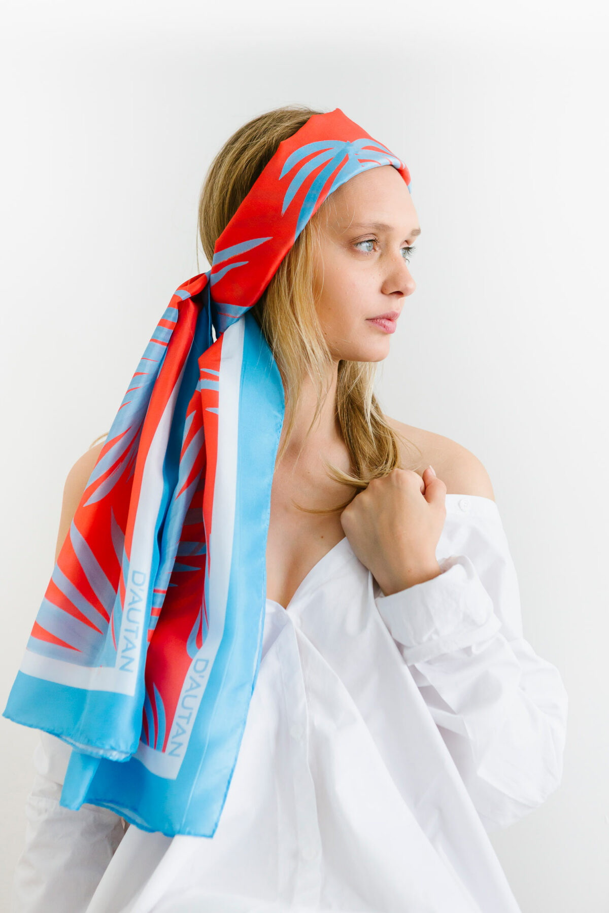 woman with a blue and red scarf on her head