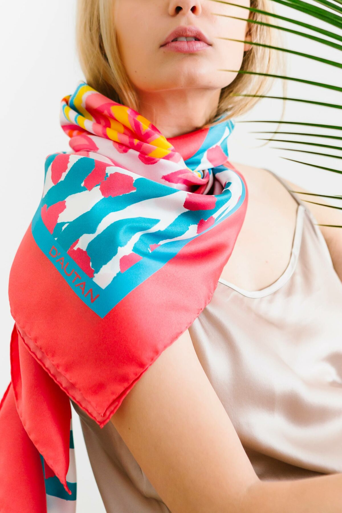woman wearing a colourful scarf on her neck