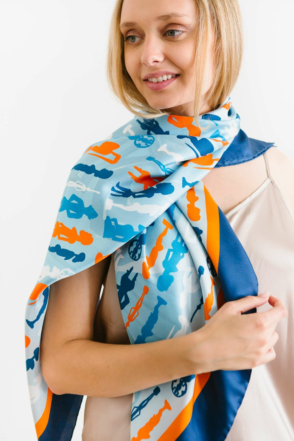 woman wearing a blue and orange scarf
