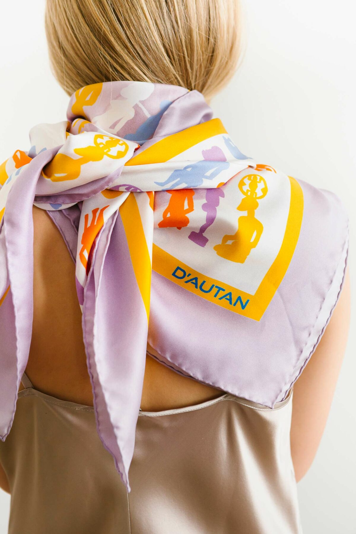 woman wearing a lilac yellow and orange scarf