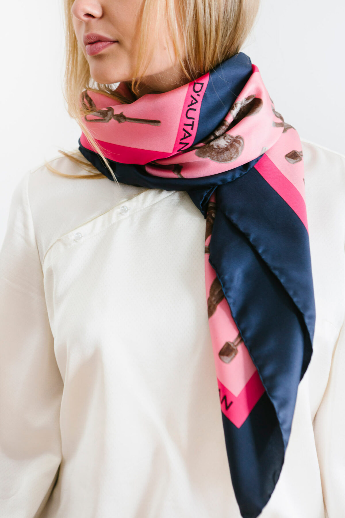 woman with a pink and marine blue scarf on herneck