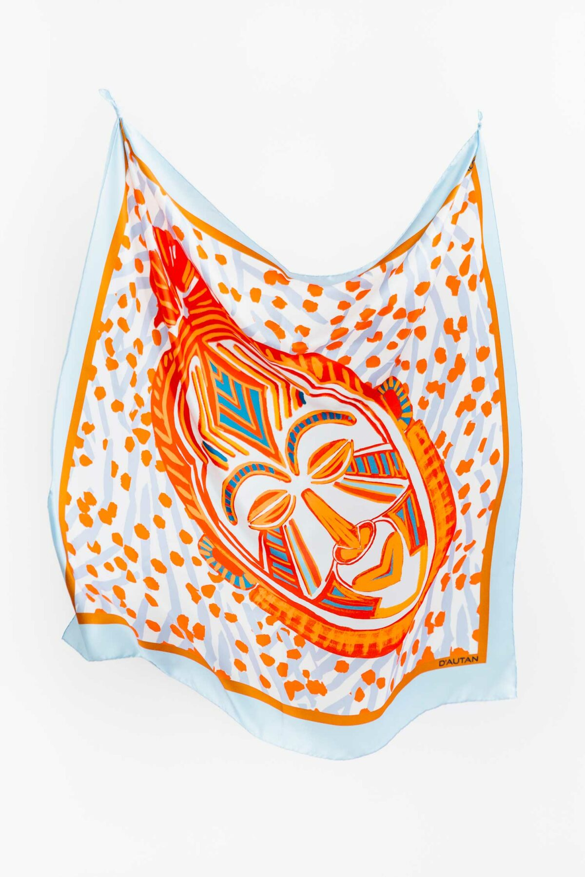 blue and orange scarf with a mask on it