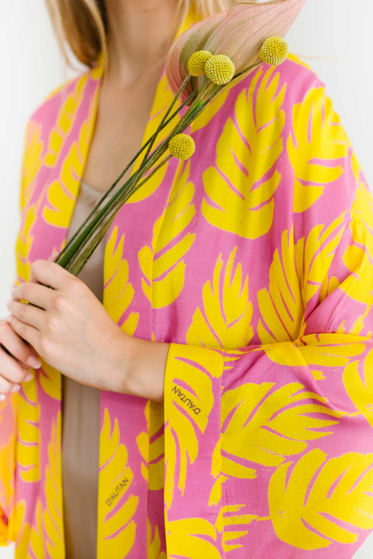 woman with a yellow and pink kimono