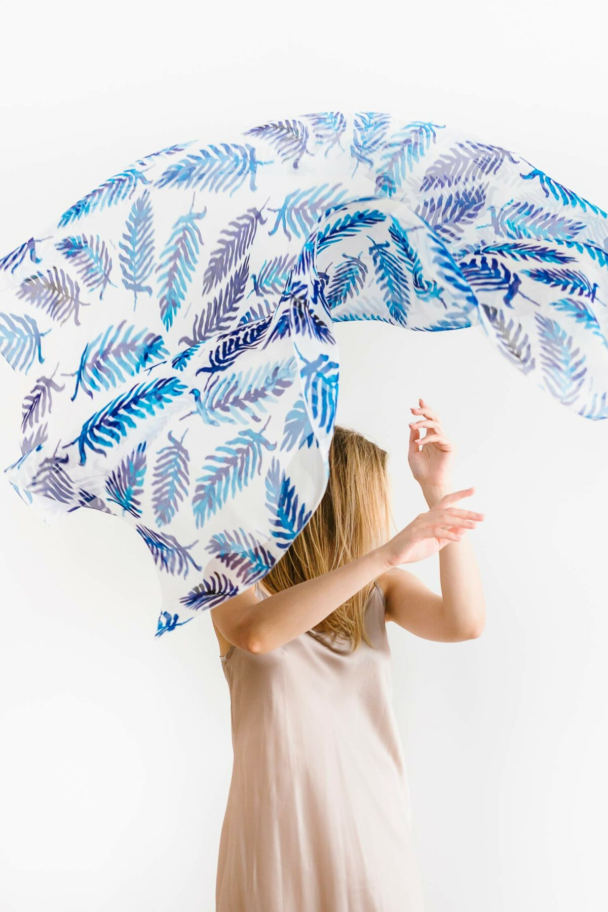 woman with a blue and white scarf above her