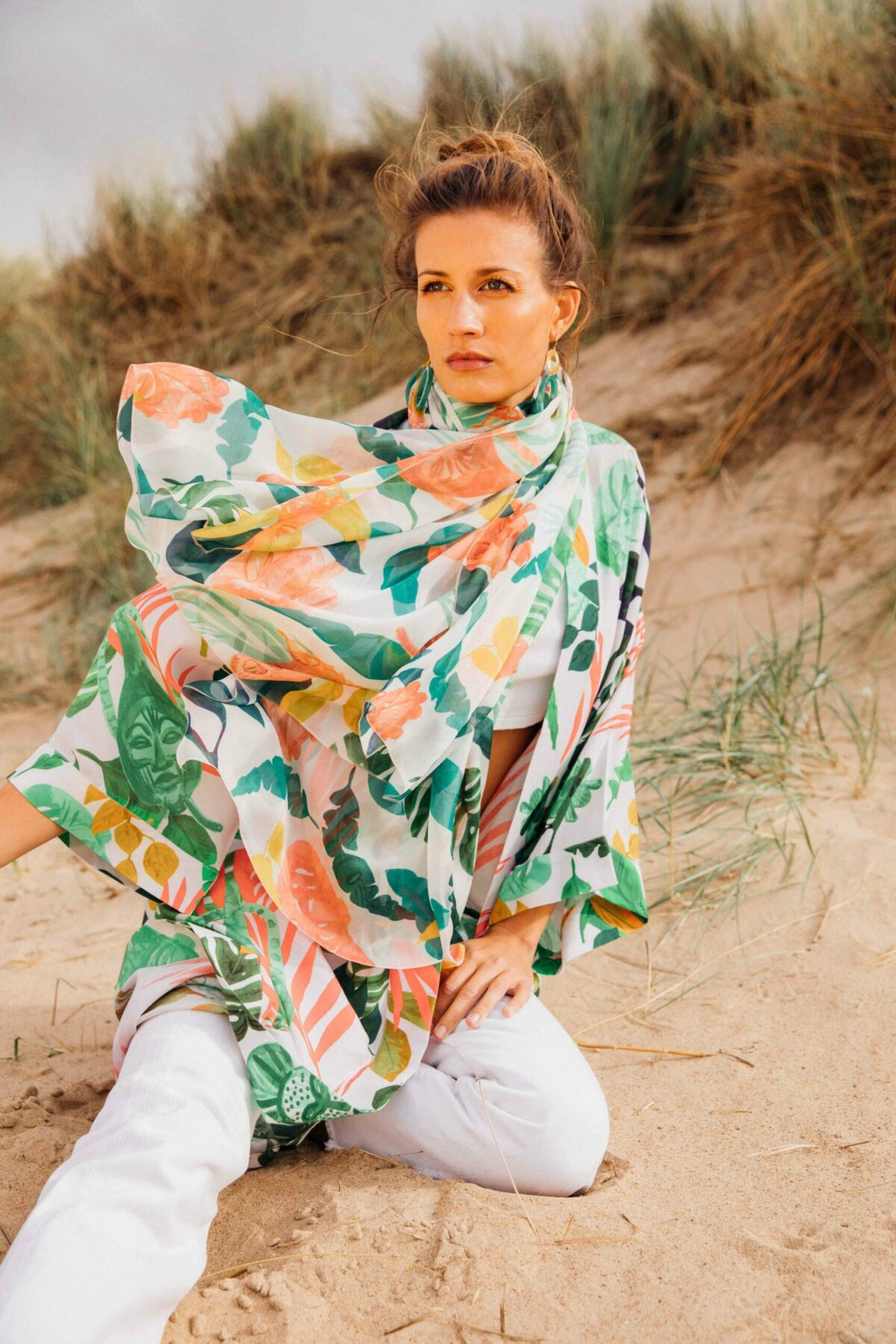 woman with a green and orange scarf