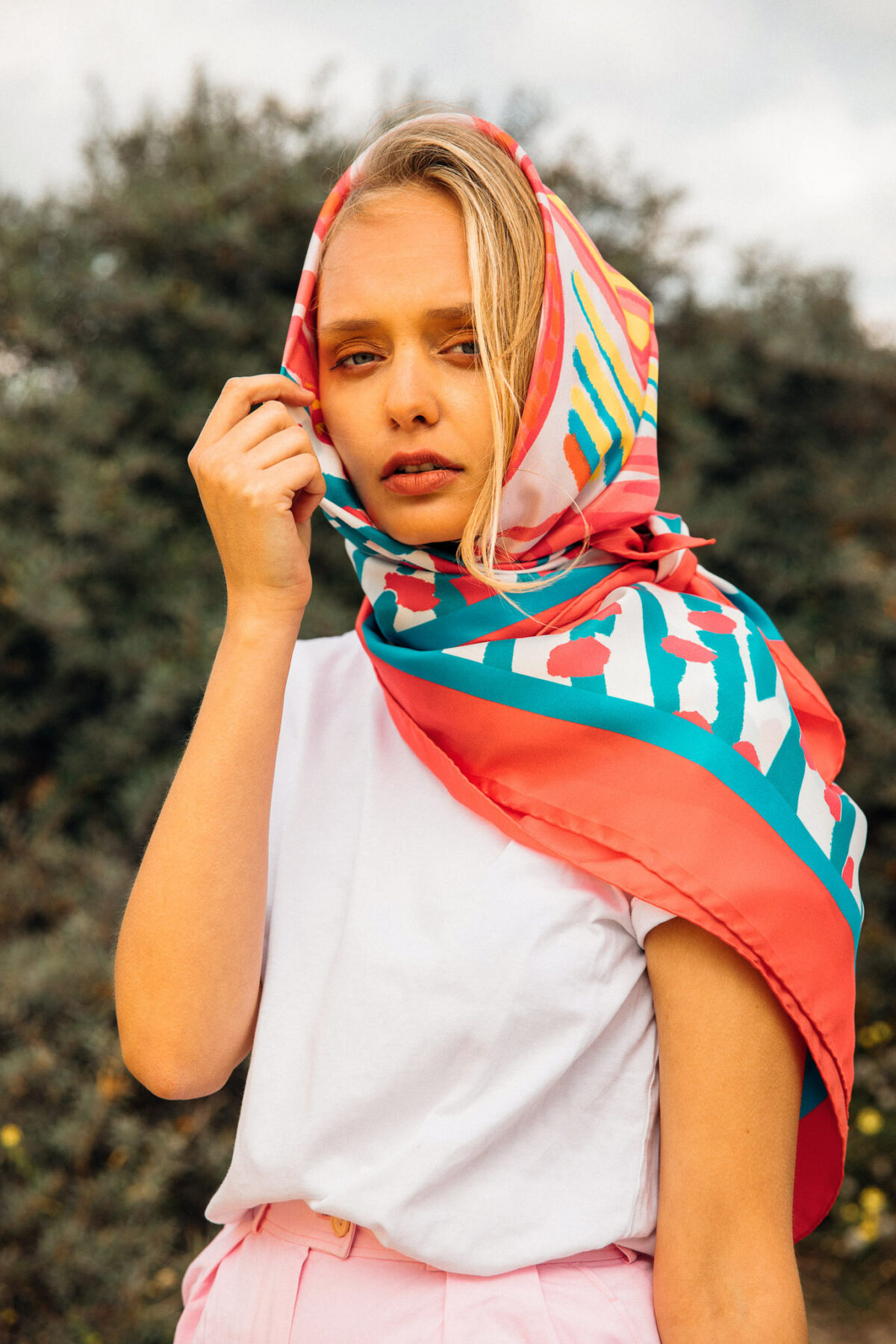 woman wearing a blue and orange scarf on her head