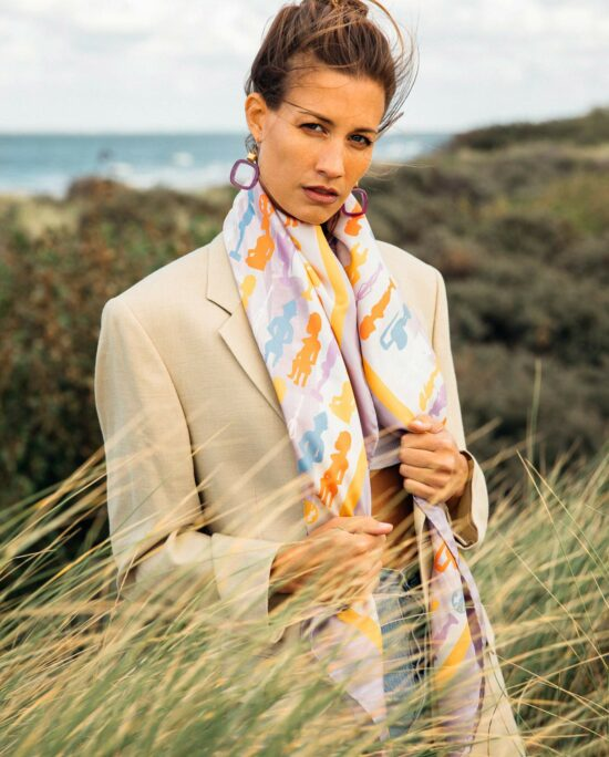 woman on the beach wearing a colourful scarf
