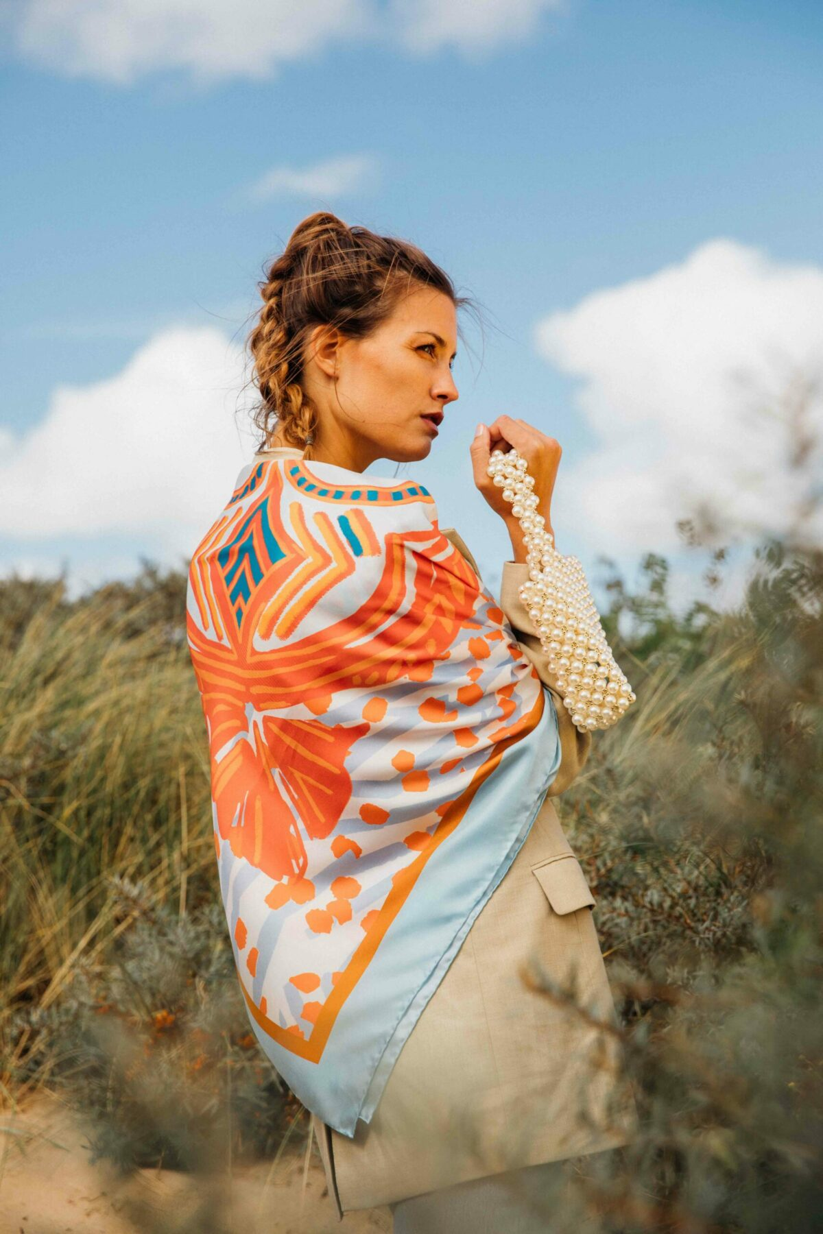 woman wearing an orange and blue scarf on her back