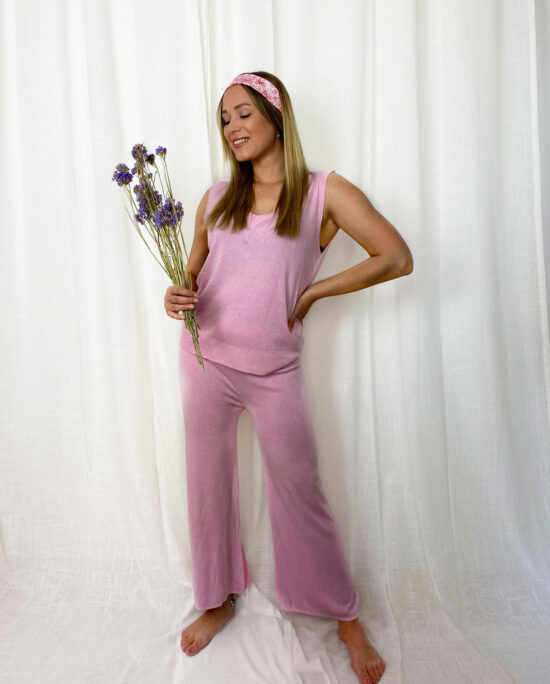 woman with a pink homesuit and a pink ribbon in hair