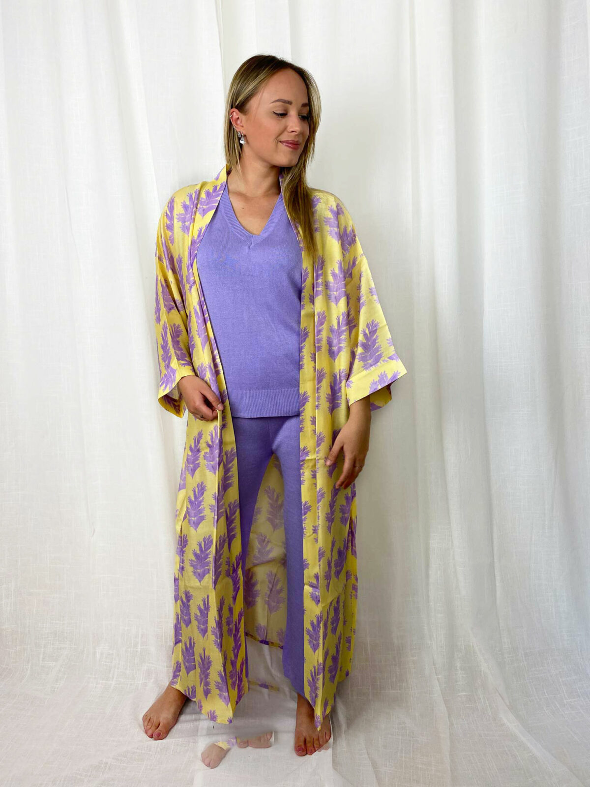 woman with a lilac home suit and a yellow kimono