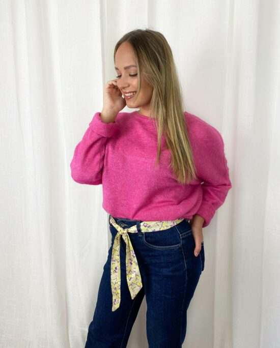 woman with a pink knitted sweater and a blue denim
