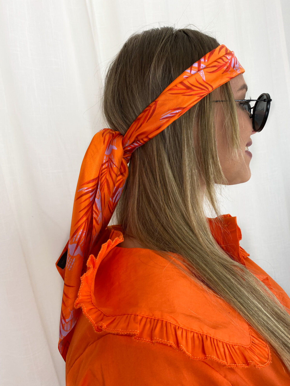 woman with an orange ribbon in her hair