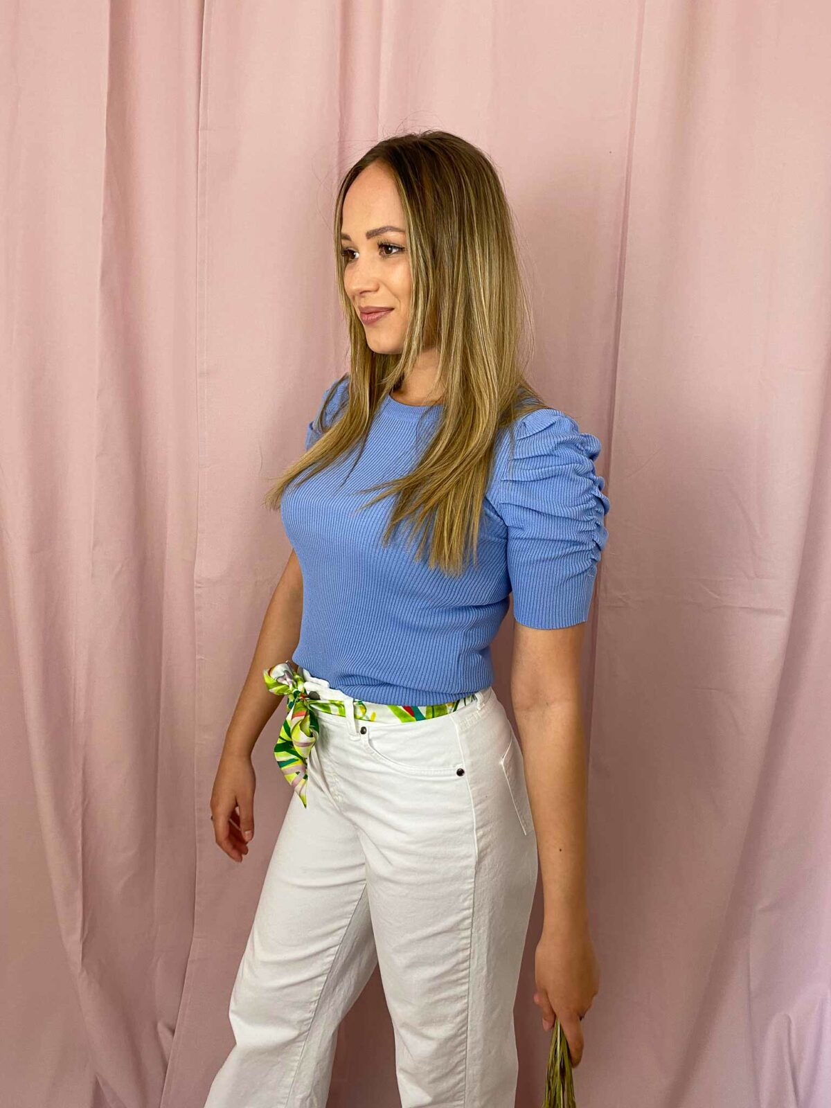 woman with a blue top and white pants
